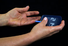 Measuring glucose level in blood Royalty Free Stock Image