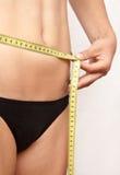 Measuring the gut girl Stock Photos