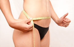 Measuring the gut girl Stock Images