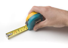 Measuring hand. Hand measuring with tape measure Royalty Free Stock Photo