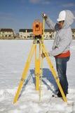 Measuring height of theodolite stock photos