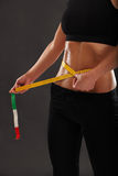 Measuring her slim waist Royalty Free Stock Photo