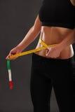Measuring her slim waist Royalty Free Stock Photo