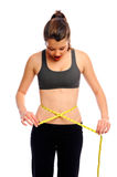 Measuring her waist Royalty Free Stock Images