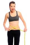 Measuring her waist Stock Image