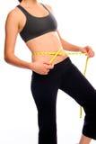 Measuring her waist Stock Photo