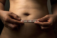 Measuring Her Waistline Royalty Free Stock Photography