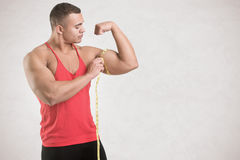 Measuring His Bicep Stock Photos