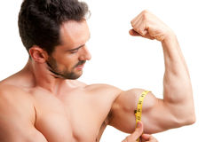 Measuring His Bicep Royalty Free Stock Images