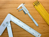 Measuring instruments. Instruments for measuring. caliper, square, measuring tape Royalty Free Stock Photos