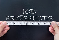 Measuring job prospects. Tape measuring the job prospects handwritten on a chalkboard stock photography