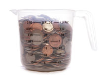 Measuring jug of sterling english money Stock Photo
