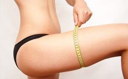 Measuring leg girl Royalty Free Stock Photo