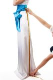 Measuring leg length close-up. Of a bride for a wedding dress royalty free stock image