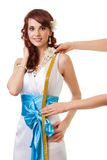 Measuring length from waist to shoulder. Of a bride for a wedding dress Stock Images