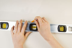 Measuring Level and Pencil for marking interior wall Stock Images