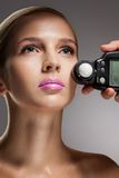 Measuring light with flash meter Royalty Free Stock Photos