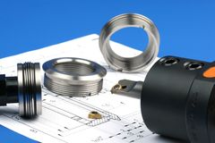 Measuring metal components stock photo
