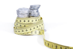 Measuring money with measurement tape Stock Photos