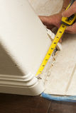 Measuring for New Baseboard with Bull Nose Corners and New Lamin Royalty Free Stock Photography