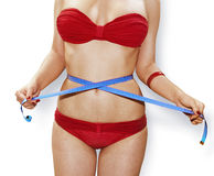 Measuring perfect shape in red underwear Stock Images