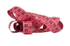 Measuring pink ribbon Stock Image