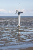 Measuring pole in dutch Waddenzee near Noordkaap. Measuring pole for measuring the tides, currents, wind speed and direction, temperature, pressure; placed after Stock Image