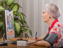 Measuring pressure during virtual doctor stay with Stock Photography