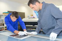Measuring a printed paper stock photo
