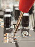 Measuring with probe on circuit board Royalty Free Stock Image