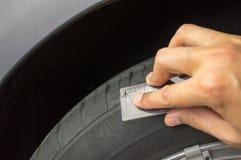 Measuring. Profile measuring at a car tire Royalty Free Stock Photos