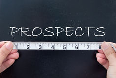 Measuring prospects. Tape measuring the word prospects written on a chalkboard stock photo