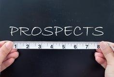 Measuring prospects. Tape measuring the word prospects written on a chalkboard Stock Photo