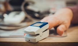 Measuring a pulse using pulse oximeter on the finger royalty free stock images
