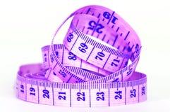 Measuring purple tape Stock Images