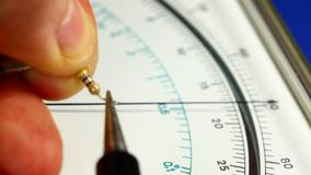 Measuring resistance with analog multimeter stock footage