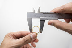 Measuring ring with vernier caliper Royalty Free Stock Photos