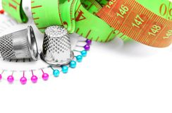 Measuring roulette, needles and thimbles Stock Image