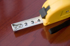 Measuring ruler. A centimeter measuring ruler on red background desk Royalty Free Stock Images