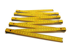 Measuring Ruler. Carpentry measuring ruler in yelow with black and red numbers Royalty Free Stock Photos