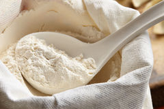 Measuring scoop with flour Stock Images