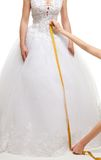 Measuring the size of skirt. Measuring the size of brides skirt with centimeter, isolated on white Stock Image