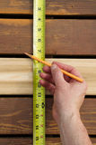 Measuring Space Between Boards Royalty Free Stock Photography