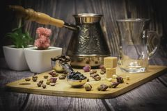 Measuring spoon for tea and coffee with coffee beans and dry tea leaves on a wooden plate stock photos