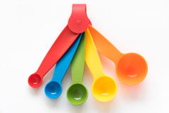 Measuring spoons. Colorful measuring spoons on white background Stock Photo