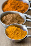 Measuring spoons with spices Stock Photo