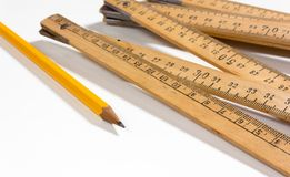 Measuring Stck and Pencil on White Background. A measuring stick and a pencil on a white background Stock Photo
