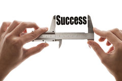Measuring success. Close up shot of a caliper measuring the word Success Royalty Free Stock Images