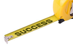 Measuring success. Concept of measuring success on a tape measure isolated on a white background Stock Image