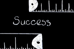 Measuring Success. Measuring Success - literal representation using Chalkboard and white chalk Royalty Free Stock Images